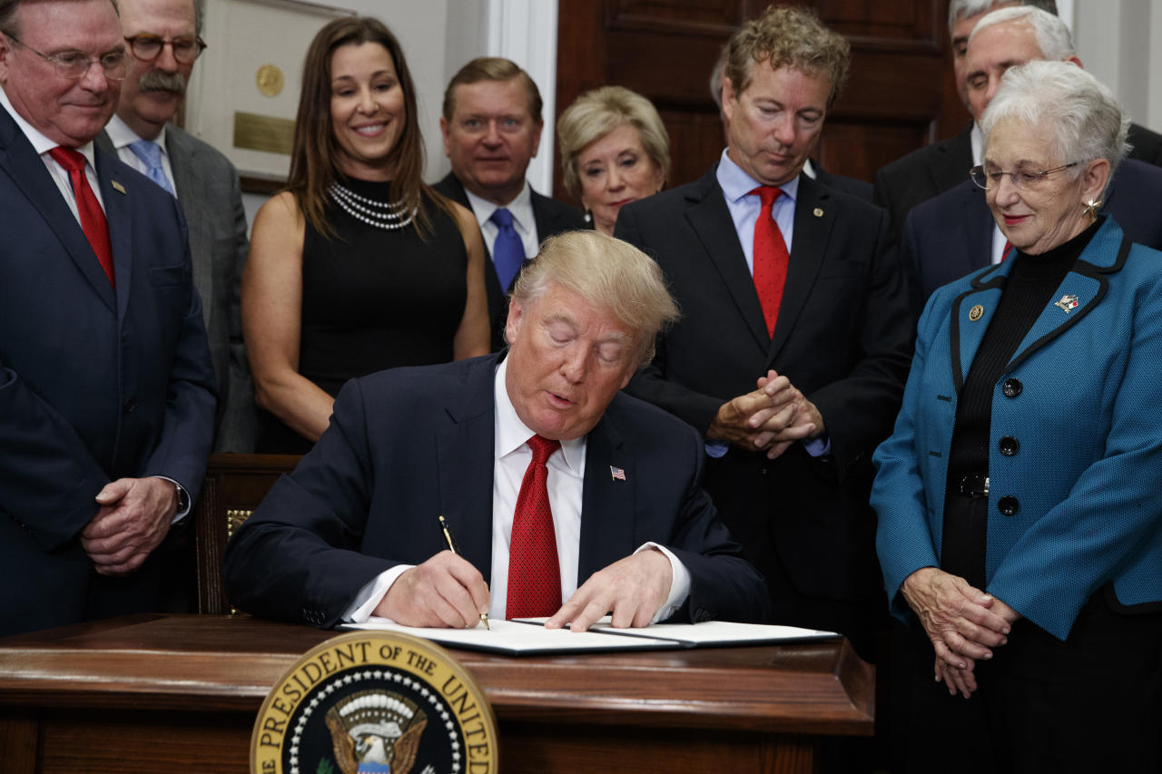 "<p> FILE - In this Thursday, Oct. 12, 2017, file photo, Dave Ratner, second from left, and others watch as President Donald Trump signs an executive order on health care in the Roosevelt Room of the White House in Washington. Ratner, owner of Dave's Soda and Pet City in Massachusetts, is under fire after he was photographed last week with Trump. Ratner said he's ""embarrassed"" and wouldn't have gone had he known Trump would also cut off federal payments to insurers. (AP Photo/Evan Vucci, File) </p>"