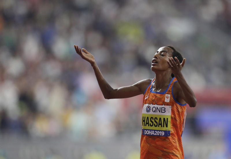 Sifan Hassan of the Netherlands celebrates winning the gold medal in the women's 10,000m final at the World Athletics Championships in Doha, Qatar, Saturday, Sept. 28, 2019. (AP Photo/Petr David Josek)