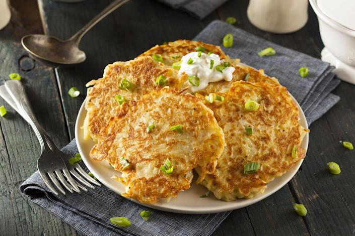 "<p>These Irish potato cakes are made with both raw grated potatoes and mashed potatoes. It's part pancake and part hash brown: what's not to love? Serve them for breakfast, dinner or a midnight snack.</p><p><a class=""link rapid-noclick-resp"" href=""https://go.redirectingat.com?id=74968X1596630&url=https%3A%2F%2Fwww.walmart.com%2Fsearch%2F%3Fquery%3Dpioneer%2Bwoman%2Bcooking%2Btools&sref=https%3A%2F%2Fwww.thepioneerwoman.com%2Ffood-cooking%2Fmeals-menus%2Fg35325053%2Ftraditional-irish-food-dishes%2F"" rel=""nofollow noopener"" target=""_blank"" data-ylk=""slk:SHOP COOKING TOOLS"">SHOP COOKING TOOLS</a></p>"