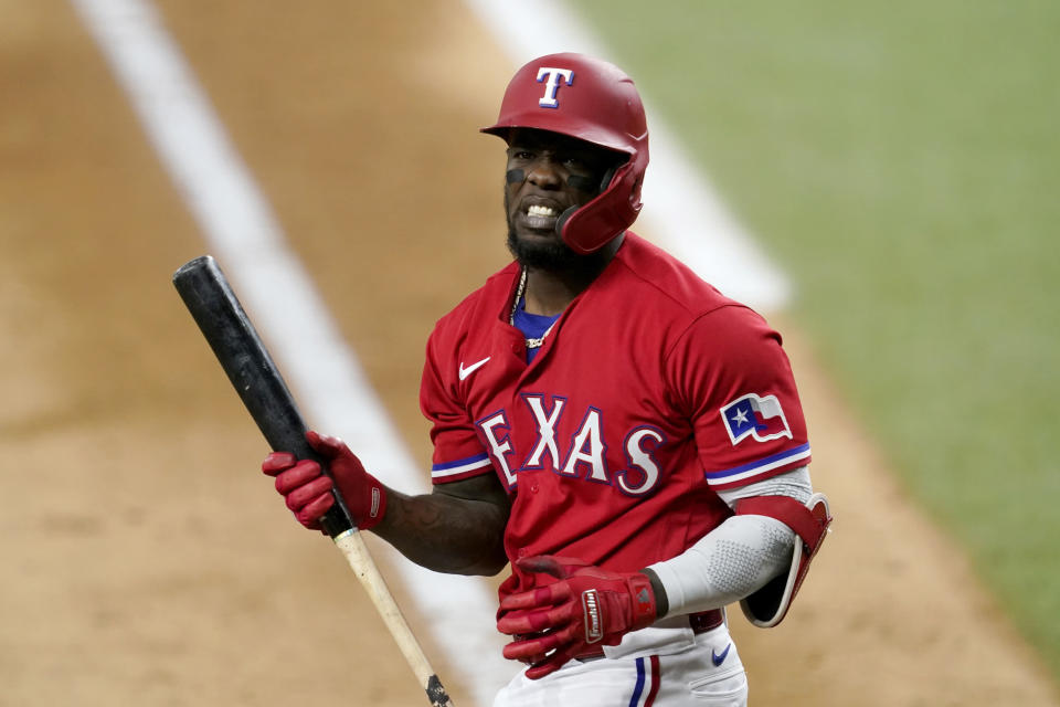 Texas Rangers' Adolis Garcia walks out of the batters box after swinging at a pitch in the seventh inning of a baseball game against the Chicago White Sox in Arlington, Texas, Friday, Sept. 17, 2021. Garcia struck out in the at-bat. (AP Photo/Tony Gutierrez)