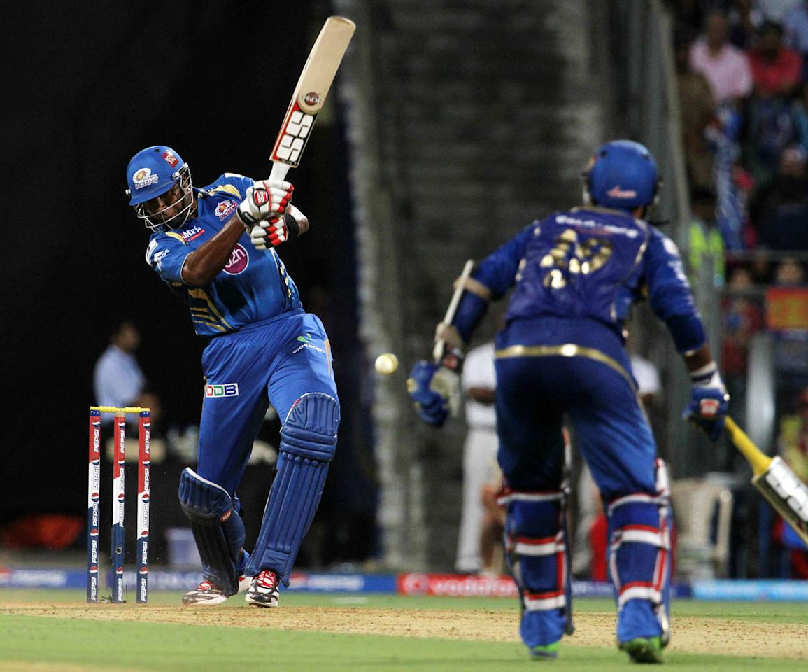 Mumbai Indian player Kieron Pollard plays a shot during match 37 of the Pepsi Indian Premier League ( IPL) 2013  between The Mumbai Indians and the Royal Challengers Bangalore held at the Wankhede Stadium in Mumbai on the 27th April 2013. (BCCI)