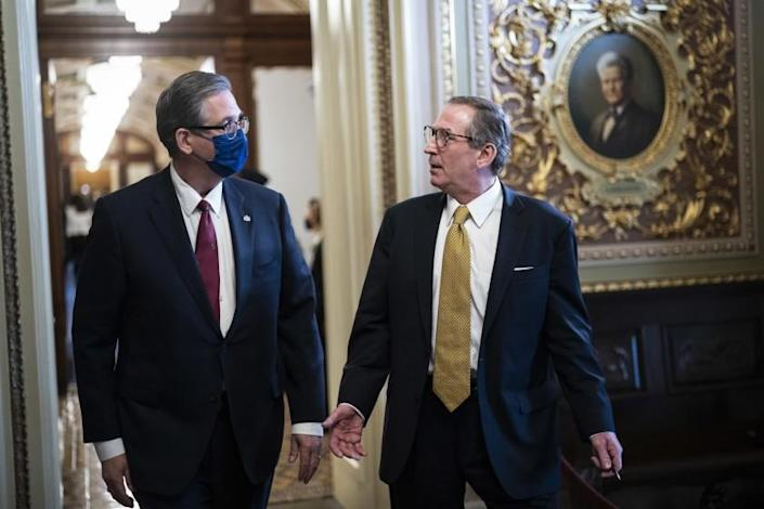 WASHINGTON, DC - FEBRUARY 12: Bruce Castor and Michael van der Veen, lawyers for former President Donald Trump, walk back to their meeting room during a break through the Senate Reception room on the fourth day of the Senate Impeachment trials for former President Donald Trump on Capitol Hill on February 12, 2021 in Washington, DC. Trump's defense lawyers will present their case on Friday, where his legal team will argue that he should be acquitted of inciting an insurrection. (Photo by Jabin Botsford - Pool/Getty Images)