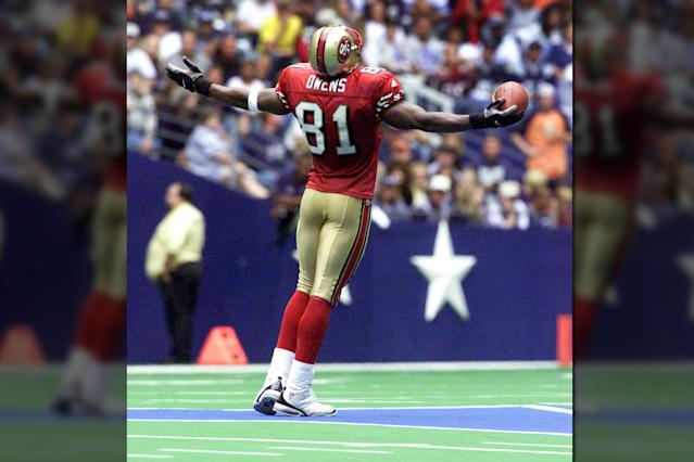In a now infamous moment, Terrell Owens celebrates scoring a touchdown for the San Francisco 49ers on top of the Dallas Cowboys star in 2000. (AP)