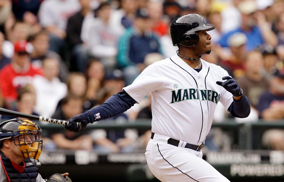 Seattle Mariners' Ken Griffey Jr., right, doubles in a run in a 2009 game.