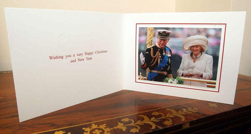 <p>Taken in 2012, the royals can be seen waving to onlookers with the Christmas card message reading: 'Wishing you a very Happy Christmas and New Year.' </p>