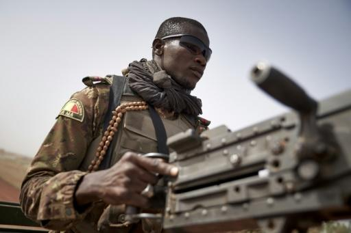 On patrol: A soldier on the perilous highway between Mopti and Djenne in central Mali