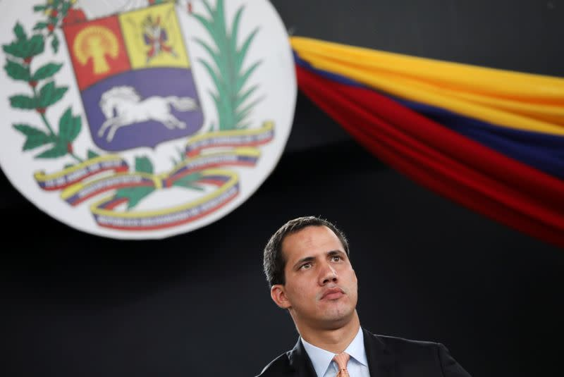 Venezuela's National Assembly President and opposition leader Juan Guaido, who many nations have recognised as the country's rightful interim ruler, attends a session of Venezuela's National Assembly taking place in an amphitheatre in Caracas
