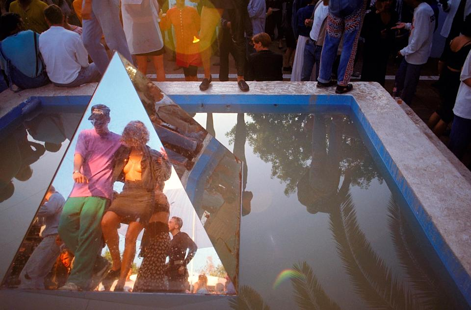 <p>A couple dancing in the morning sunshine reflected in the mirrored pyramid at Amnesia</p>Dave Swindells