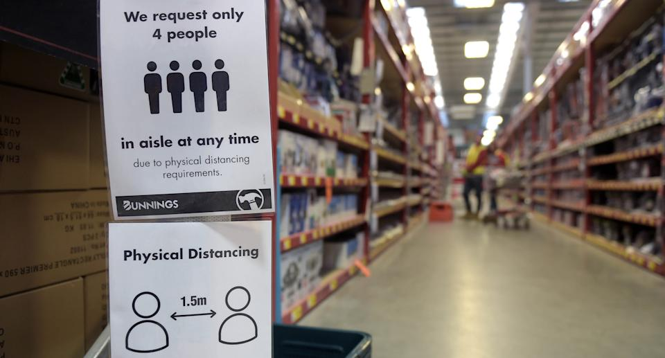 Customer information notices are displayed at the entrance to an aisle at a Bunnings Warehouse store during a partial lockdown imposed due to the coronavirus in Melbourne, Australia, on Monday, May 25, 2020. Source: Getty Images