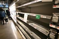 Customers are scrambling to stock up on supplies, leaving empty shelves in many grocery stores, such as this organic supermarket in Manhattan on March 13 (AFP Photo/Johannes EISELE)