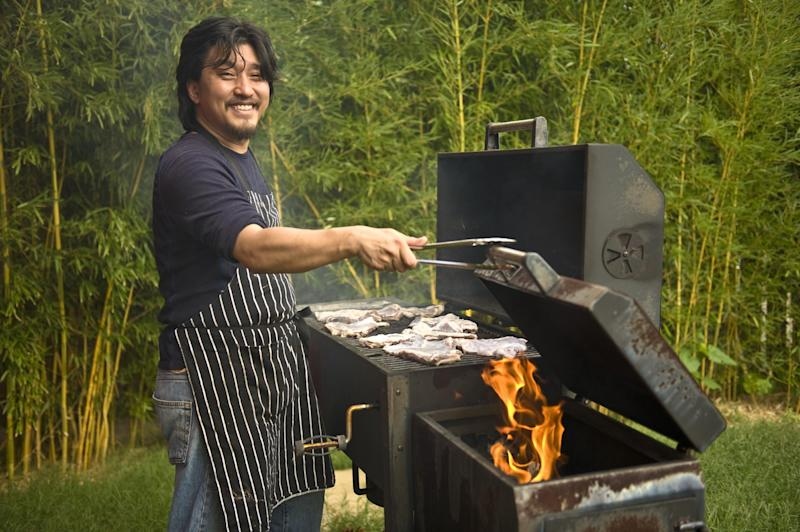 """In this June 2012 publicity photo provided by Artisan Books, Chef Edward Lee grills lamb in Louisville, K.Y. Lee recommends lamb barbecue for its smokiness and simplicity in his book, """"Smoke & Pickles,"""" published by Artisan Books. AP Photo/Artisan Books, Grant Cornett)"""