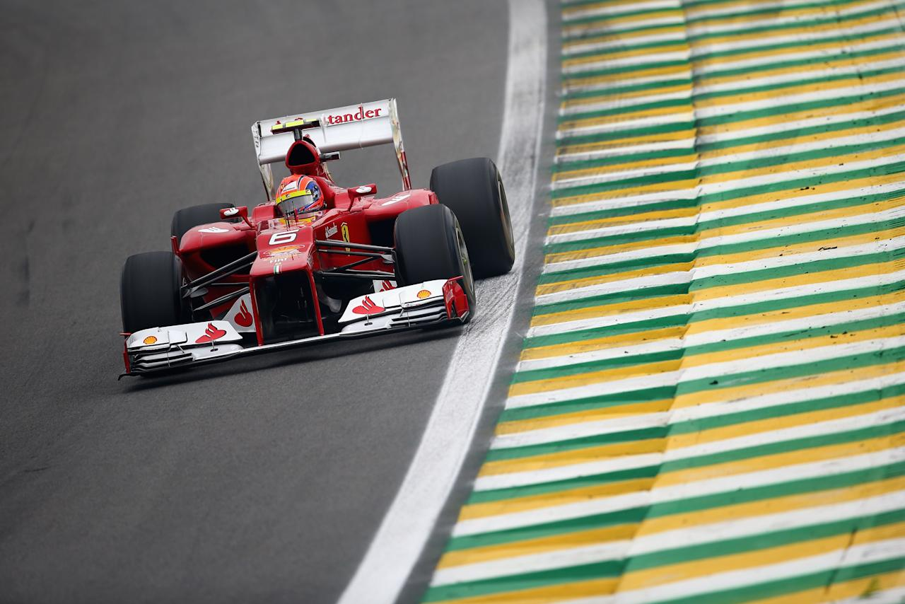 SAO PAULO, BRAZIL - NOVEMBER 24:  Felipe Massa of Brazil and Ferrari drives during qualifying for the Brazilian Formula One Grand Prix at the Autodromo Jose Carlos Pace on November 24, 2012 in Sao Paulo, Brazil.  (Photo by Clive Mason/Getty Images)