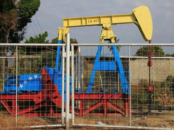 An oil pumpjack painted with the colours of the Venezuelan flag (Reuters)