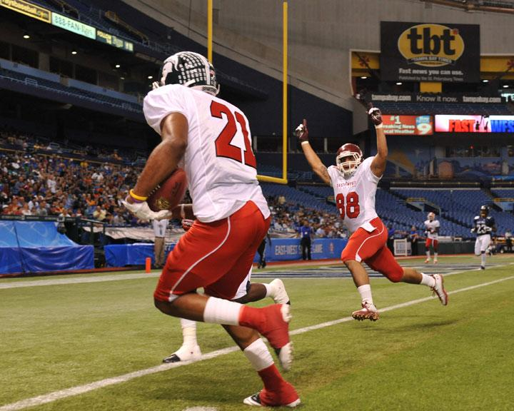 ST. PETERSBURG, FL - JANUARY 21: Wide receiver B. J. Cunningham of the Michigan State University Spartans runs for a first-quarter touchdown  during the 87th annual East-West Shrine game January 21, 2012 at Tropicana Field in St. Petersburg, Florida. (Photo by Al Messerschmidt/Getty Images)