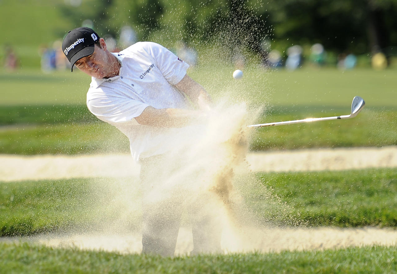 Jimmy Walker hits out of a bunker on the 16th hole during the first round of the AT&T National golf tournament at Congressional Country Club in Bethesda, Md., Thursday, June 28, 2012. (AP Photo/Nick Wass)