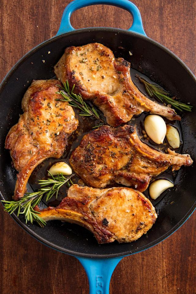 "<p>This skillet alone will make your kitchen smell amazing.</p><p>Get the recipe from <a rel=""nofollow"" href=""https://www.delish.com/cooking/recipe-ideas/recipes/a58720/oven-baked-pork-chops-recipe/"">Delish</a>.</p>"
