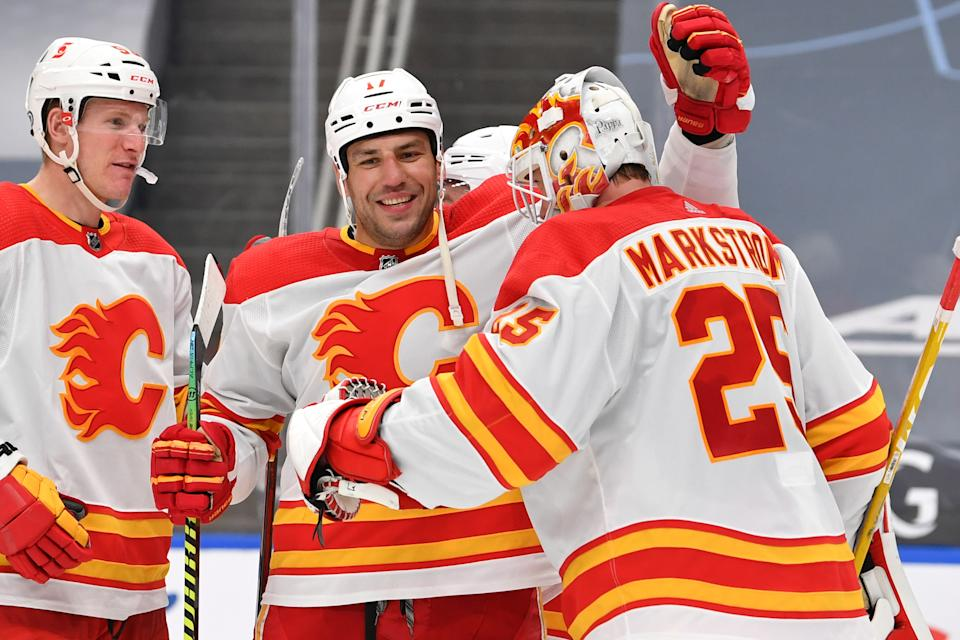 EDMONTON, AB - APRIL 29:  Jacob Markstrom #25 and Milan Lucic #17 of the Calgary Flames celebrate after winning the game against the Edmonton Oilers on April 29, 2021 at Rogers Place in Edmonton, Alberta, Canada. (Photo by Andy Devlin/NHLI via Getty Images)