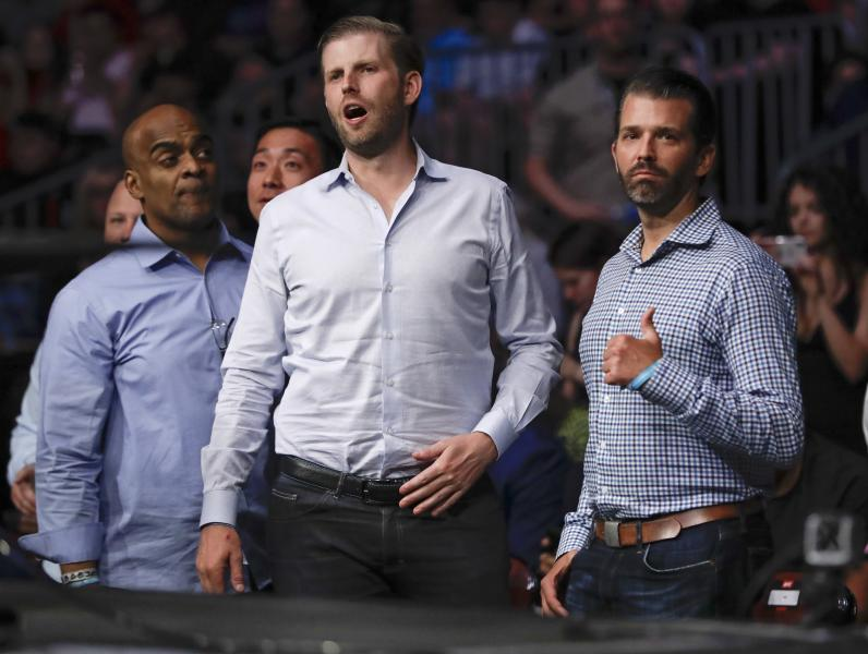Donald Trump Jr., right, poses for a photo with Eric Trump at UFC Fight Night Saturday, Aug. 3, 2019, in Newark, N.J. Guida stopped Miller in the first round. (AP Photo/Frank Franklin II)