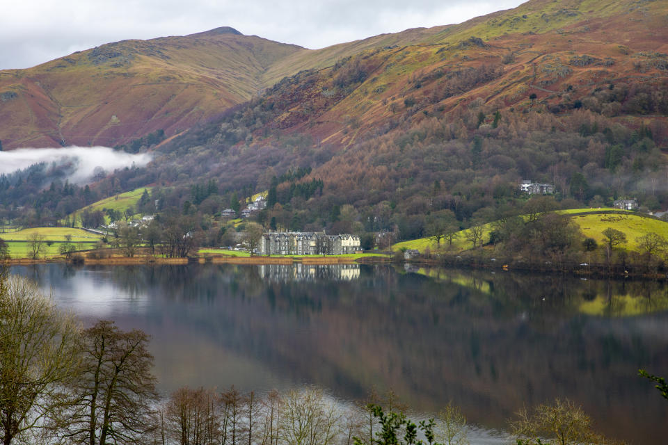Early morning mist over Lake Grasmere in the Lake District National Park. (Photo by: Martin Berry/Loop Images/Universal Images Group via Getty Images)