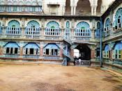 The construction was overseen by B. P. Raghavulu Naidu, an executive engineer in the Mysore Palace division. He had conducted elaborate architectural studies during his visits to Delhi, Madras, and Calcutta, and these were used in planning for the new palace.