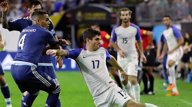 <p>Christian Pulisic of the USA reaches for the ball against Gabriel Mercado of Argentina during the Copa America Centenario semifinal match on June 21, 2016 in Houston.</p>