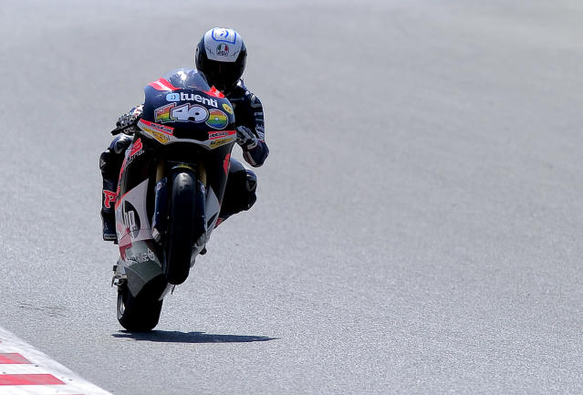 Pons 40 HP Tuenti's Spanish Pol Espargaro makes a wheelie at the Catalunya racetrack in Montmelo, near Barcelona, on June 2, 2012, during Moto2 qualifying session of the Catalunya Moto GP Grand Prix. AFP PHOTO / JOSEP LAGOJOSEP LAGO/AFP/GettyImages