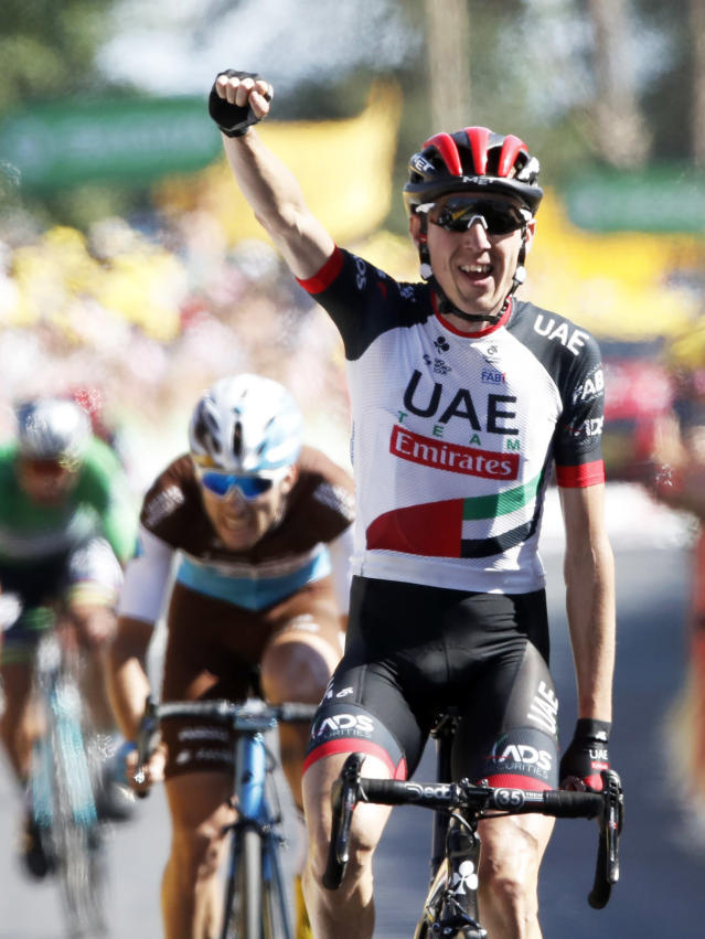 Ireland's Daniel Martin celebrates as he crosses the finish line to win the sixth stage of the Tour de France cycling race over 181 kilometers (112.5 miles) with start in Brest and finish in Mur-de-Bretagne Guerledan, France, Thursday, July 12, 2018. France's Pierre Roger Latour finished second. (AP Photo/Christophe Ena )