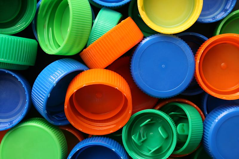 A pile of colourful bottle caps