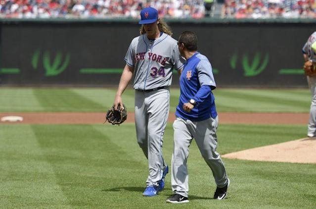 Noah Syndergaard exits with an injury after 1.1 innings in Washington. (AP Photo)