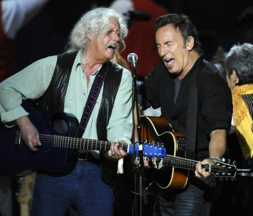 Bruce Springsteen (R) and Arlo Guthrie, who both drew inspiration from the storied career of the latter's father, perform during a concert for folk music legend Pete Seeger's 90th birthday in 2009