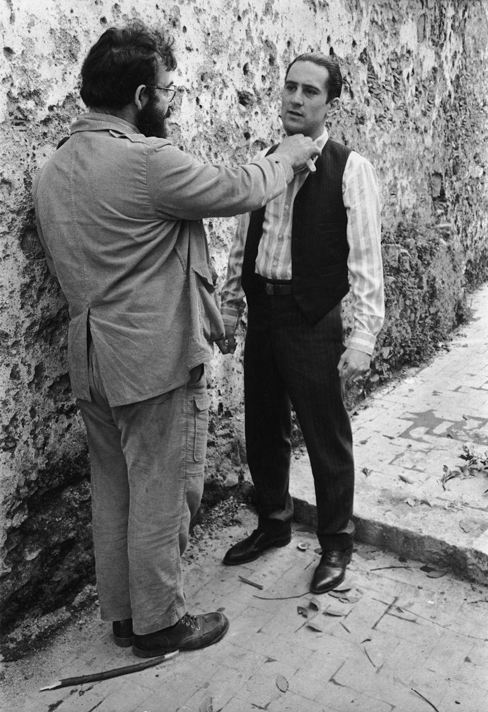 <p>Coppola holds a knife to De Niro's throat while directing him for a scene.</p>