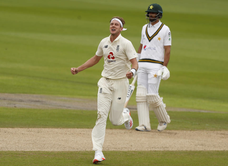 England's Stuart Broad, left, celebrates the dismissal of Pakistan's Asad Shafiq during the second day of the first cricket Test match between England and Pakistan at Old Trafford in Manchester, England, Thursday, Aug. 6, 2020. (Lee Smith/Pool via AP)