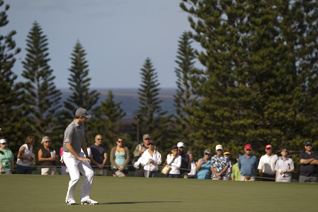 Jordan Spieth reacts to his long putt on the second green during the second round of the Tournament of Champions golf tournament, Saturday, Jan. 4, 2014, in Kapalua, Hawaii. (AP Photo/Marco Garcia)