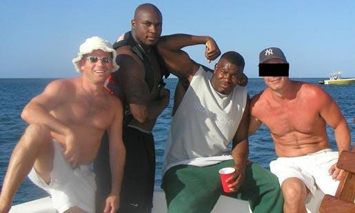 From left to right, Nevin Shapiro, D.J. Williams and Cornelius Green on the back of Shapiro's $1.6 million yacht in the summer of 2003.