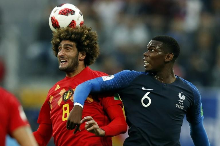 Physical battle: Paul Pogba (right) in action against Manchester United teammate Marouane Fellaini in the France v Belgium World Cup semi-final
