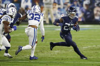 Tennessee Titans running back Derrick Henry (22) carries the ball against Indianapolis Colts free safety Julian Blackmon (32) in the first half of an NFL football game Thursday, Nov. 12, 2020, in Nashville, Tenn. (AP Photo/Wade Payne)