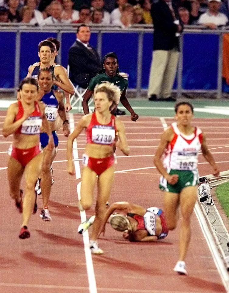 U.S. runner Suzy Favor Hamilton falls during the women's 1,500 meter final at the Summer Olympics Saturday, Sept. 30, 2000, at Olympic Stadium in Sydney. Gold medal winner Nouria Merah-Benida of Algeria is at right. (AP Photo/Rusty Kennedy)