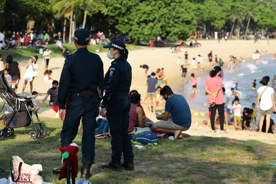 Auxillary police officers seen on duty at East Coast Park 25 December. (PHOTO: Getty Images)