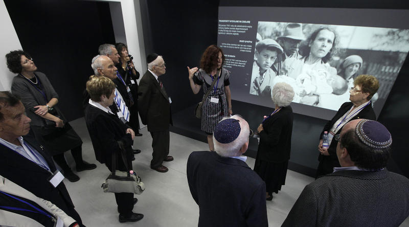 People visit the exhibition SHOAH at the Auschwitz-Birkenau State Museum, Block 27 during the opening of a new pavilion at the former Nazi death camp of Auschwitz, in Oswiecim, Poland, on Thursday, June 13, 2013. The exhibition in Bloc 27 was curated by Israel's Yad Vashem Institute Chairman Avner Shalev. It is meant to educate visitors about the Holocaust and the Nazi Germany's quest to exterminate the Jewish people.The event closed Netanyahu's two-day visit to Poland that was steeped in symbolism, as it focused on the Jewish people's painful history there during World War II as well as on the strong relations between Poland and the Jewish state today. (AP Photo/Czarek Sokolowski)