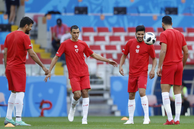 Tunisia players warm up during Tunisia's official training ahead of the group G match between Belgium and Tunisia at the 2018 soccer World Cup in the Spartak Stadium in Moscow, Russia, Sunday, June 17, 2018. (AP Photo/Hassan Ammar)