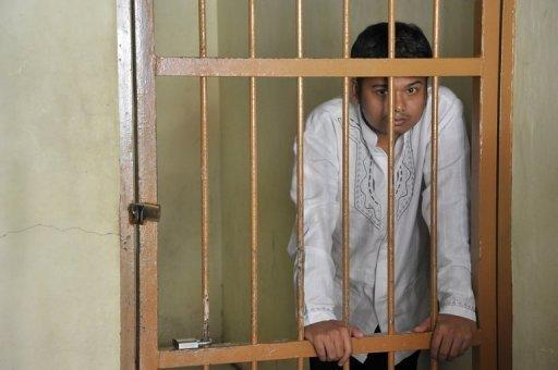 Alexander Aan waits in the jail holding area at the Muaro Sijunjung district court