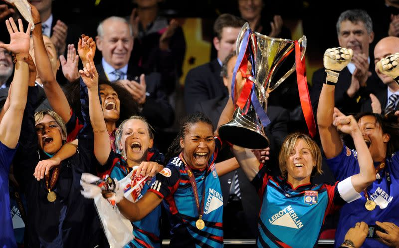 FILE PHOTO: Olympique Lyonnais players celebrate after sealing a 2-0 victory over Germany's FCC Turbine Potsdam in the Women's Champions League final at Craven Cottage, London.
