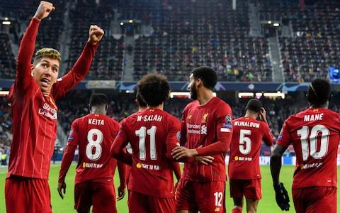 <span>Liverpool players celebrate Mohamed Salah's audacious goal that sealed the European champions' place in the knockout stages of the Champions League</span> <span>Credit: Getty Images </span>