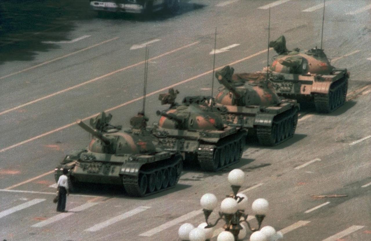 FILE -This is a June 5, 1989 file photo of a Chinese man as he stands alone to block a line of tanks heading east on Beijing's Cangan Blvd. in Tiananmen Square . (AP Photo/Jeff Widener, File)
