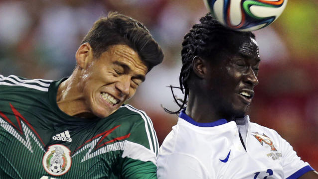 Mexico defender Hector Moreno, left, tries to keep Portugal forward Eder away from the ball during the first half of their friendly soccer match in Foxborough, Mass., Friday, June 6, 2014. (AP Photo/Charles Krupa)
