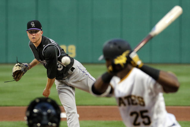 Colorado Rockies starting pitcher Kyle Freeland delivers in the fourth inning of a baseball game against the Pittsburgh Pirates in Pittsburgh, Monday, June 12, 2017. (AP Photo/Gene J. Puskar)