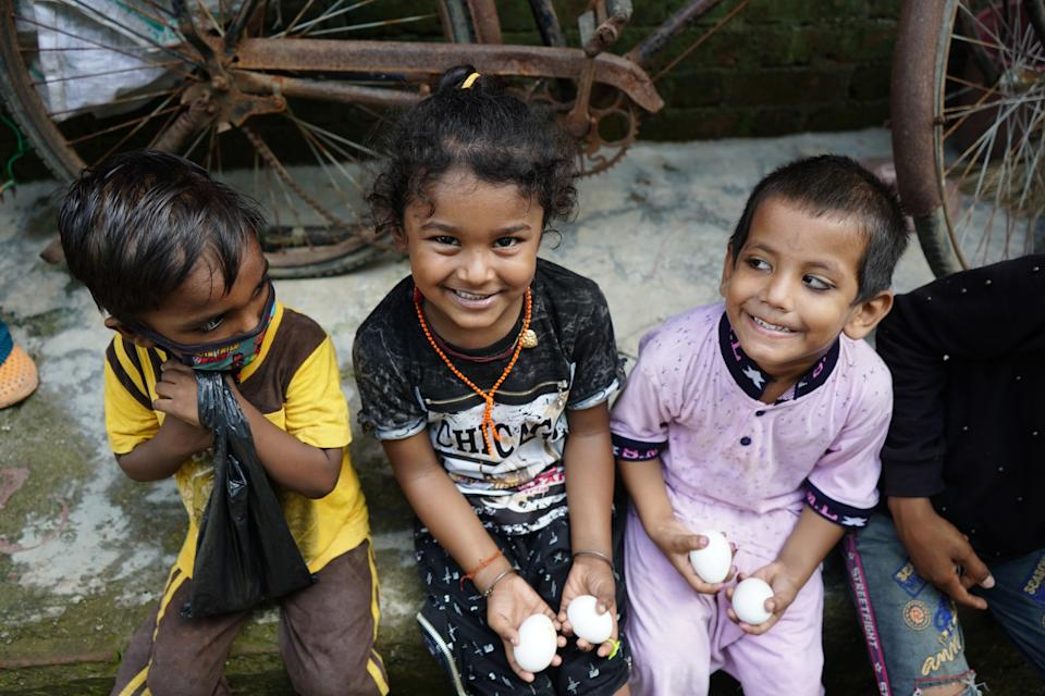 Kids smiling after they got their eggs at Malwani.