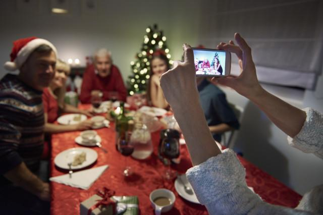 how to take great holiday photos with your phone unrecognizable person taking photography of the family