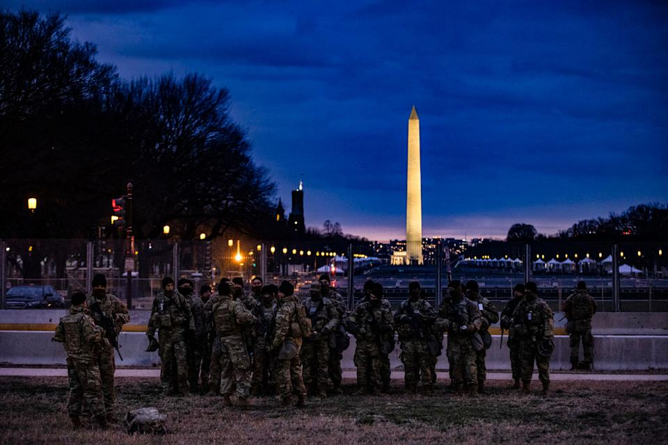 Soldiers from Bravo Company, 1st Battalion, 116th Infantry Brigade Combat Team, Virginia National Guard stand watch on the National Mall on January 17.