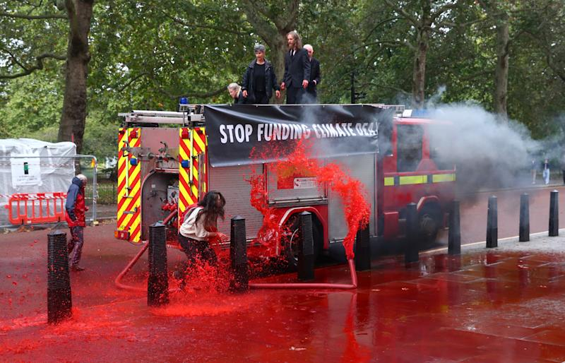Extinction Rebellion spray fake blood onto the Treasury in climate protest